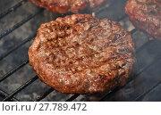 Купить «Meat burgers for hamburger on smoke grill», фото № 27789472, снято 17 июля 2019 г. (c) PantherMedia / Фотобанк Лори