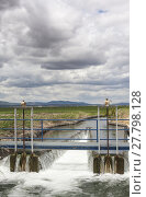Купить «Floodgate area at huge irrigation canal, Extremadura, Spain», фото № 27798128, снято 22 марта 2019 г. (c) PantherMedia / Фотобанк Лори