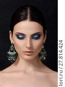 Portrait of beautiful brunet woman with blue earrings. Стоковое фото, фотограф Людмила Дутко / Фотобанк Лори