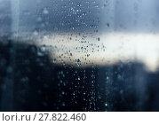Купить «Rain drops on glass reflection», фото № 27822460, снято 24 февраля 2019 г. (c) PantherMedia / Фотобанк Лори