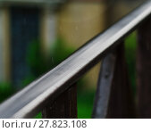 Купить «Horizontal balcony handrails under rain super detailed closeup a», фото № 27823108, снято 21 ноября 2018 г. (c) PantherMedia / Фотобанк Лори