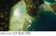Купить «Coron, Palawan, Philippines, aerial view of beautiful Twin lagoon and limestone cliffs. Fisheye view.», видеоролик № 27824708, снято 5 февраля 2018 г. (c) Mikhail Davidovich / Фотобанк Лори