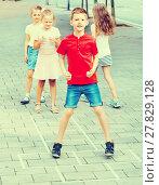 Купить «Kids in elementary school age playing hopscotch», фото № 27829128, снято 20 февраля 2019 г. (c) Яков Филимонов / Фотобанк Лори