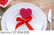 Купить «close up of red heart shaped lollipop on plate», видеоролик № 27834028, снято 10 февраля 2018 г. (c) Syda Productions / Фотобанк Лори