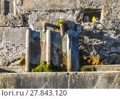 Купить «old water fountain at a farm house at Seigne des Alps», фото № 27843120, снято 22 мая 2019 г. (c) PantherMedia / Фотобанк Лори