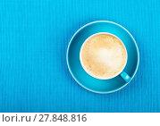 Купить «Full cappuccino latte coffee in blue cup top view», фото № 27848816, снято 27 мая 2020 г. (c) easy Fotostock / Фотобанк Лори