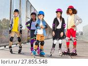Купить «Happy schoolboy rollerblading with mates outdoors», фото № 27855548, снято 14 октября 2017 г. (c) Сергей Новиков / Фотобанк Лори