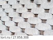 Купить «Close up patterns and textures of curved interlocking concrete retaining wall bricks», фото № 27858308, снято 19 декабря 2018 г. (c) PantherMedia / Фотобанк Лори