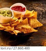 Купить «Plate full of guacamole, salsa and nacho chips», фото № 27860480, снято 20 марта 2019 г. (c) PantherMedia / Фотобанк Лори