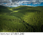 Купить «Aerial view of mountains covered with coniferous forests», фото № 27861240, снято 19 октября 2019 г. (c) PantherMedia / Фотобанк Лори
