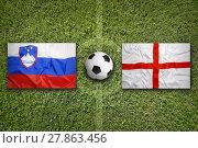 Купить «Slovenia vs. England flags on soccer field», фото № 27863456, снято 19 февраля 2019 г. (c) PantherMedia / Фотобанк Лори