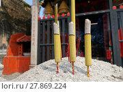 Купить «Three burning incense in front of Chinese temple», фото № 27869224, снято 21 октября 2019 г. (c) PantherMedia / Фотобанк Лори