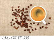Купить «Full espresso cup and coffee beans on canvas», фото № 27871380, снято 15 августа 2018 г. (c) PantherMedia / Фотобанк Лори