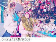 Купить «Happy mother with daughter buying decorations for Xmas», фото № 27879608, снято 21 сентября 2018 г. (c) Яков Филимонов / Фотобанк Лори