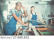 Купить «Worker male is ready to work on circular saw in assembly shop», фото № 27880832, снято 19 июля 2017 г. (c) Яков Филимонов / Фотобанк Лори