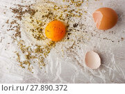 Купить «Broken egg with herbs mix on the white table», фото № 27890372, снято 17 июня 2019 г. (c) PantherMedia / Фотобанк Лори