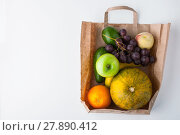 Купить «Assorted fruit inside a paper bag», фото № 27890412, снято 17 июня 2019 г. (c) PantherMedia / Фотобанк Лори
