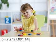 Купить «Little child girl plays in kindergarten in Montessori preschool class.», фото № 27891148, снято 19 сентября 2018 г. (c) Оксана Кузьмина / Фотобанк Лори