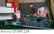 Купить «Portrait of electrician builder engineer during work», видеоролик № 27891224, снято 20 марта 2019 г. (c) Константин Шишкин / Фотобанк Лори
