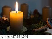 Купить «first candle on the advent wreath burns in dark surroundings», фото № 27891544, снято 19 июля 2019 г. (c) PantherMedia / Фотобанк Лори
