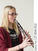 Купить «girl plays clarinet», фото № 27894552, снято 18 марта 2019 г. (c) PantherMedia / Фотобанк Лори