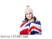 Купить «Beautiful patriotic vivacious young woman with the American flag held in her outstretched hands standing in front of an expanse of white sand», фото № 27897588, снято 24 июня 2018 г. (c) PantherMedia / Фотобанк Лори