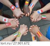 Купить «International brothers and sisters standing in a circle together and holding hands», фото № 27901672, снято 25 июня 2018 г. (c) PantherMedia / Фотобанк Лори