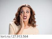 Купить «The calling for silence girl or woman on gray background», фото № 27913564, снято 23 октября 2018 г. (c) PantherMedia / Фотобанк Лори