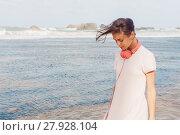 Купить «Woman walking on the beach sand», фото № 27928104, снято 21 мая 2018 г. (c) PantherMedia / Фотобанк Лори
