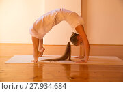 Купить «Woman practicing Yoga in a Attic..», фото № 27934684, снято 23 апреля 2019 г. (c) PantherMedia / Фотобанк Лори