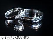 Купить «Wedding day details - two lovely golden wedding rings awaiting their moment», фото № 27935480, снято 17 июня 2019 г. (c) PantherMedia / Фотобанк Лори