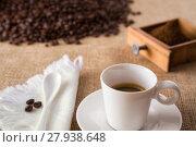Купить «Coffee with coffee-beans on jute», фото № 27938648, снято 25 апреля 2019 г. (c) PantherMedia / Фотобанк Лори