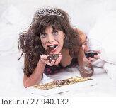 Купить «Upset Woman in Tiara Drinking Wine and Gulipng Down Chocolates in Bedroom», фото № 27940132, снято 20 марта 2018 г. (c) PantherMedia / Фотобанк Лори