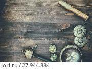 Купить «Singing Bowl, magic balls, drum and drum plate on a wooden background», фото № 27944884, снято 23 апреля 2019 г. (c) PantherMedia / Фотобанк Лори