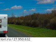 Купить «part of a camper trailer on the highway», фото № 27950632, снято 20 марта 2018 г. (c) PantherMedia / Фотобанк Лори
