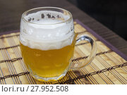 Купить «Glass mug of unfiltered weizen beer on table», фото № 27952508, снято 19 октября 2018 г. (c) PantherMedia / Фотобанк Лори