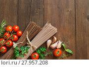 Купить «Three types of spaghetti, tomatoes and herbs», фото № 27957208, снято 19 октября 2018 г. (c) PantherMedia / Фотобанк Лори