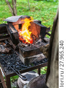 Купить «Blacksmith heats steel rod in forging furnace», фото № 27965240, снято 18 октября 2018 г. (c) PantherMedia / Фотобанк Лори