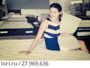 Купить «Female sitting with pillow on mattress», фото № 27969636, снято 29 августа 2017 г. (c) Яков Филимонов / Фотобанк Лори