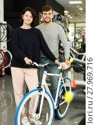 Купить «couple standing with bicycle», фото № 27969716, снято 8 января 2018 г. (c) Яков Филимонов / Фотобанк Лори