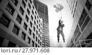 Купить «Businessman floating with balloons over surreal city buildings perspective», фото № 27971608, снято 16 октября 2018 г. (c) Wavebreak Media / Фотобанк Лори