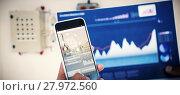 Купить «Composite 3d image of cropped image of hand holding mobile phone and graph», фото № 27972560, снято 23 февраля 2019 г. (c) Wavebreak Media / Фотобанк Лори