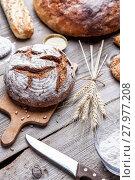 Купить «Delicious fresh bread on wooden background», фото № 27977208, снято 19 октября 2018 г. (c) PantherMedia / Фотобанк Лори