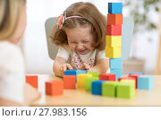 Купить «Funny kid and mom play together with educational toys», фото № 27983156, снято 16 января 2020 г. (c) Оксана Кузьмина / Фотобанк Лори