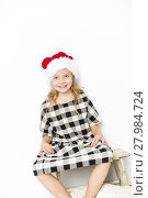 Купить «happy christmas girl in santa hat on white background», фото № 27984724, снято 23 марта 2019 г. (c) PantherMedia / Фотобанк Лори