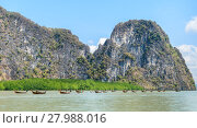 Купить «Limestone island with mangrove forest and long-tail wooden boats in Phang Nga Bay National Park, Thailand», фото № 27988016, снято 22 июля 2019 г. (c) PantherMedia / Фотобанк Лори
