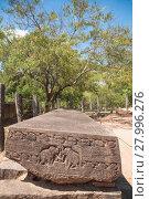 Купить «Gal Potha or stone book inscription in ancient city of Polonnaruwa, Sri Lanka», фото № 27996276, снято 22 сентября 2019 г. (c) PantherMedia / Фотобанк Лори