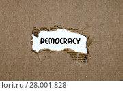 Купить «The word democracy appearing behind torn paper», фото № 28001828, снято 4 июля 2020 г. (c) PantherMedia / Фотобанк Лори