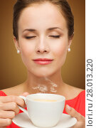 Купить «beautiful woman in red dress with cup of coffee», фото № 28013220, снято 1 июня 2014 г. (c) Syda Productions / Фотобанк Лори