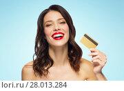 Купить «beautiful woman with red lipstick and credit card», фото № 28013284, снято 5 января 2018 г. (c) Syda Productions / Фотобанк Лори